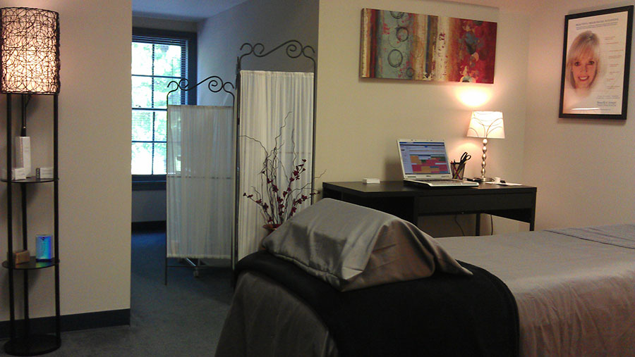 Relaxing microcurrent treatment room at Beautiful Image Anti Aging, LLC's Charlotte location.